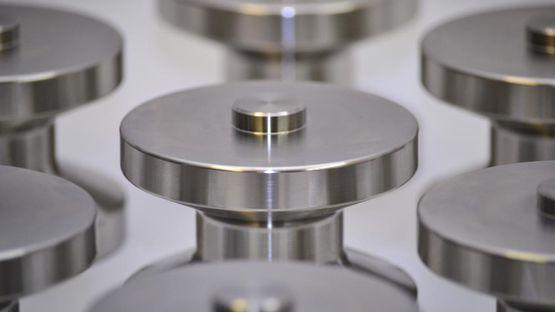 Batch produced metal components